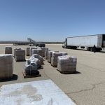 Humanitarian aid on Tarmac waiting to be shipped to Iraq